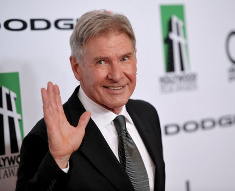 Harrison Ford waves at the camera
