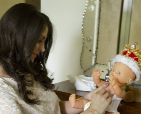 Kate changes nappies on a doll