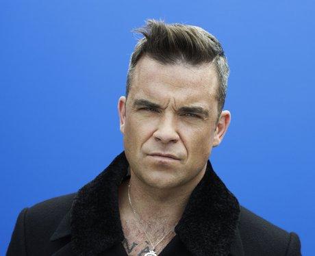 Robbie in a black coat
