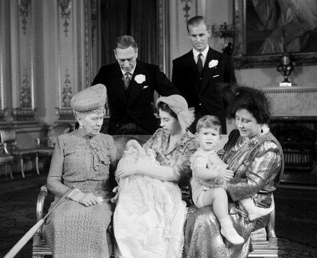 the queen holds baby princess anne