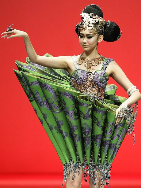 a model in a green couture dress