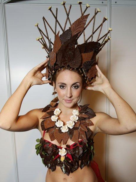 A model wears a chocolate bikini and hat