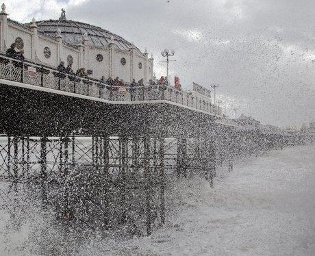 breaking waves at brighton pier