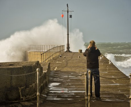 man takes photographs of waves in cornwall