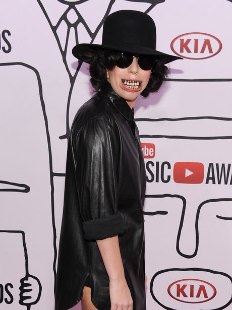 Lady Gaga wearing grills and a black shirt