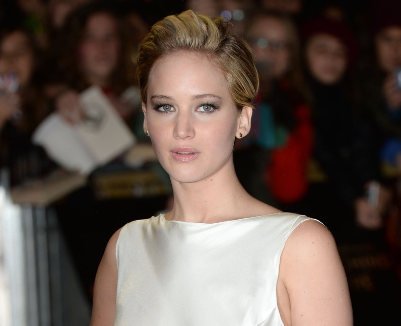 Jennifer Lawrence in a white dress with short hair