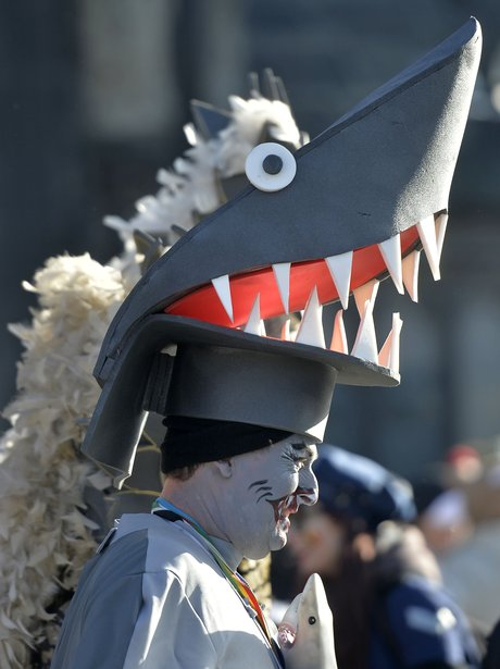 A man dressed as a shark forms part of the Hoppeditz parade