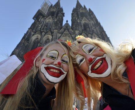 Two women dressed as clowns