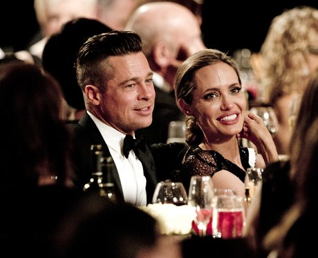Brad Pitt and Angelina Jolie in black tie at charity event