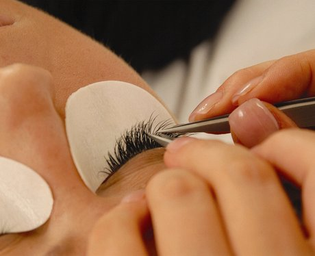 eye lashes being applied