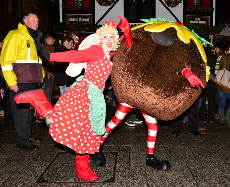 A person dressed up as a Christmas pudding