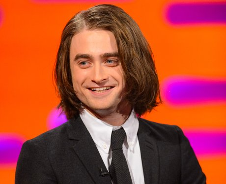Daniel Radcliffe in a tuxedo with long hair on TV show