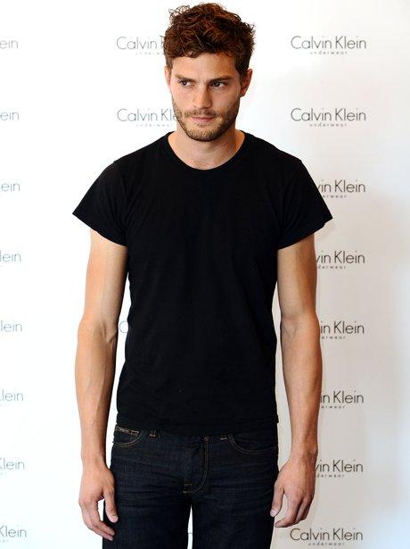 Jamie Dornan in black t-shirt at a Calvin Klein event