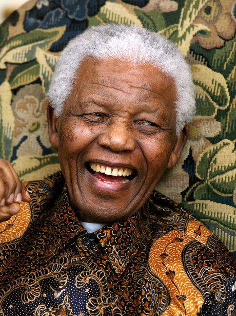Nelson Mandela laughing in a colourful shirt