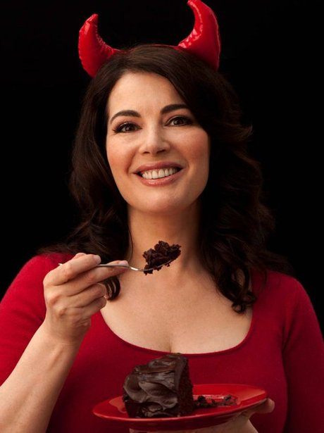 Nigella Lawson wears devil horns and eats cake