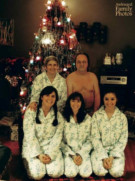 A family in pyjamas with the dad half naked