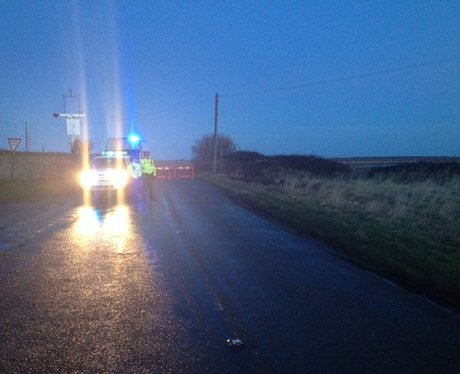 Cley Helicopter Crash Cordon with police car.