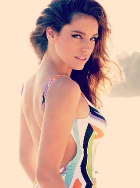 Kelly Brook wears multicoloured swimsuit