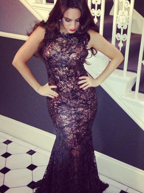 Kelly Brook pours her curves into a dress