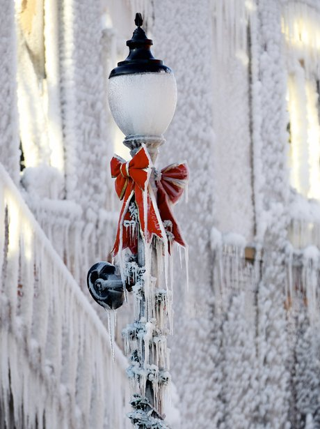 A lampost covered in icicles