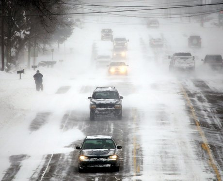 Cars driving on a snowy road