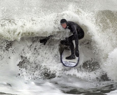 A man surfing a big wave.