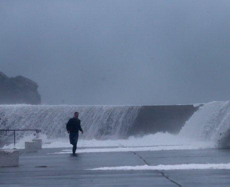 Waves battering flood defences.