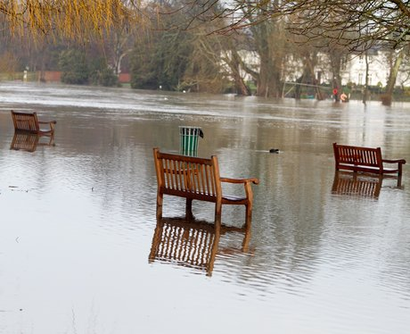 Some benches in a flooded park.