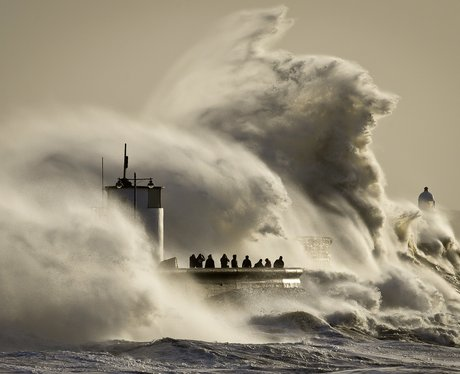 Waves battering a lighthouse.