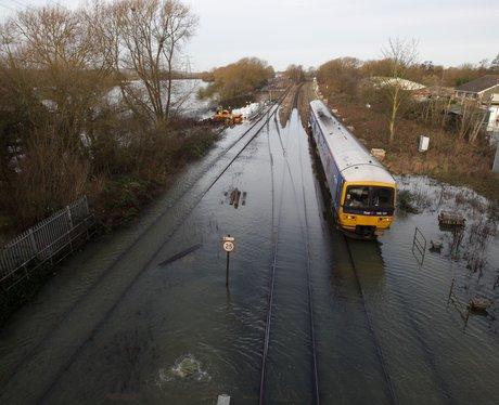 A train driving though floods