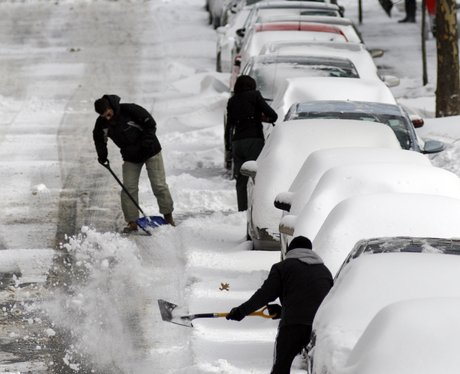 People clearing snow from roads