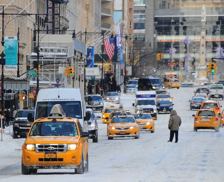 Taxi's driving on a snowy road in New York City