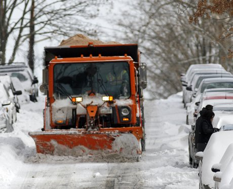 A snow plough clearing roads