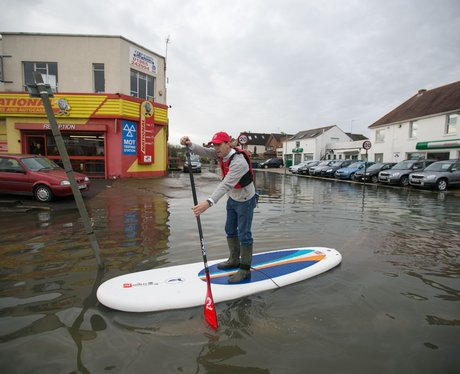 A man in a paddle board