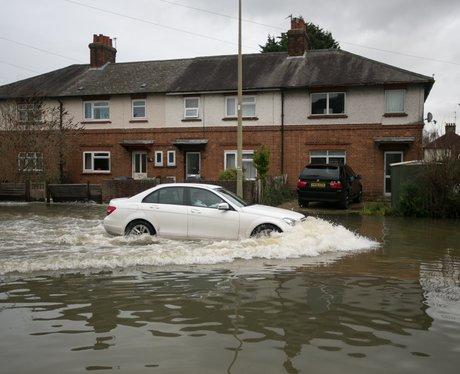A car driving down a flooded road