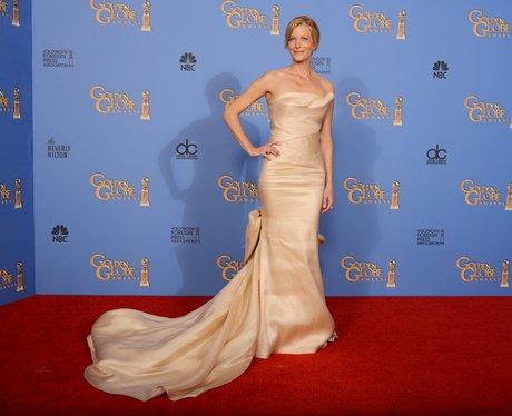 Anna Gunn in a gold dress