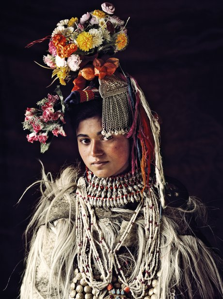 A woman with a floral hat