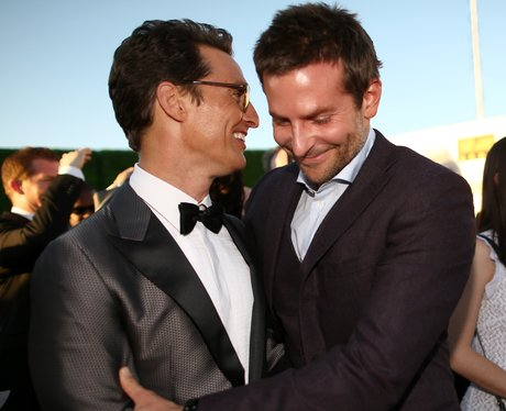Matthew McConaughey and Bradley Cooper hug on the red carpet