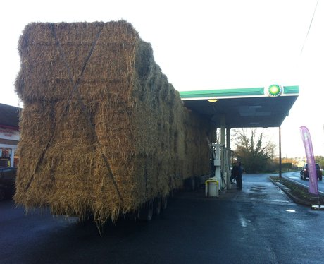Lorry carrying some hay crashes in to station