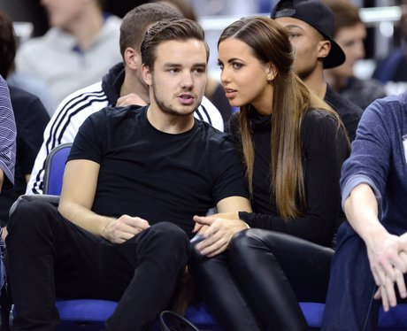 Liam Payne and Girlfriend watching a basket ball game