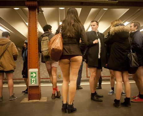 People boarding public transport with no trousers