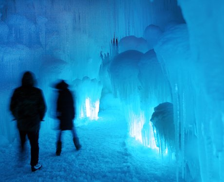 Ice caves lit up with a blue light