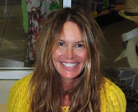 Elle Macpherson wearing no makeup and smiling