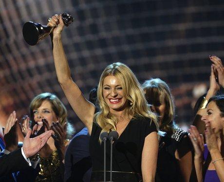 tess daly holding an award