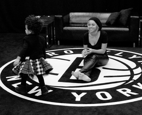Beyonce and her daughter playing together