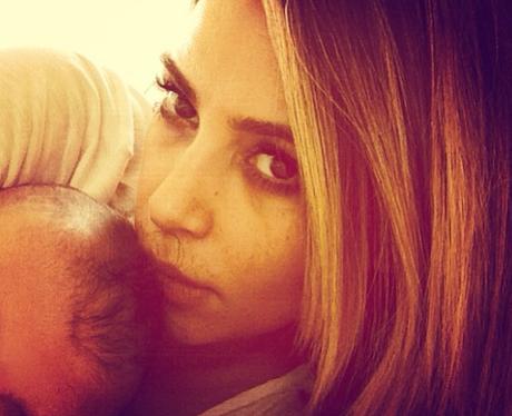 Kim Kardashian hugging baby
