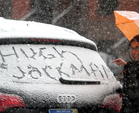 Hugh Jackman's name in snow on the back of a car