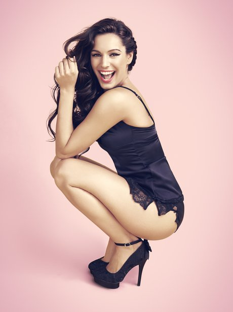 Kelly Brook wearing camisole briefs and high heels