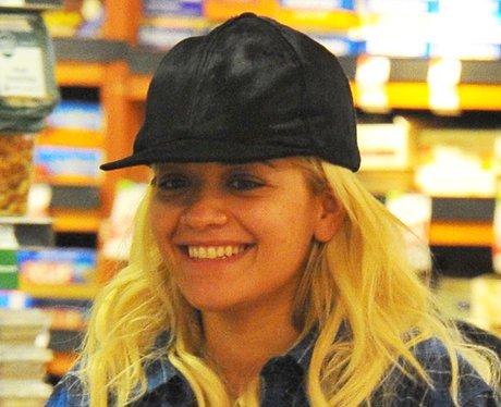 Rita Ora buys groceries makeup free.