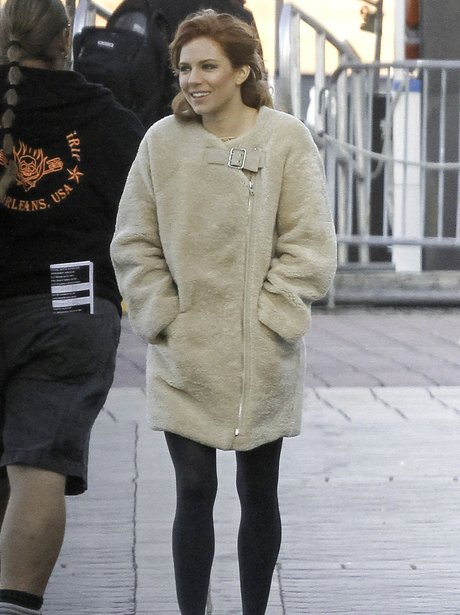Sienna Miller on set with red hair